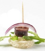 anchovy-canape-garnished-with-arugula-and-onion-