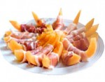 appetizers-melon-with-ham-nuts-canapes-and-black-olives-